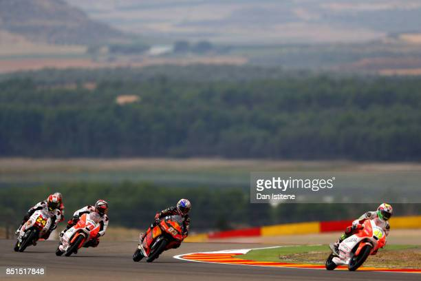 Tatsuki Suzuki of Japan and SIC58 Squadra Corse Albert Arenas of Spain and Aspar Mahindra Moto3 Niccolo Antonelli of Italy and Red Bull KTM Ajo and...