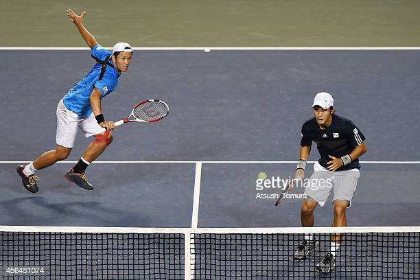 Tatsuma Ito and Go Soeda of Japan in action during the men's doubles first round match against Rohan Bopanna and Leander Paes of India on day three...