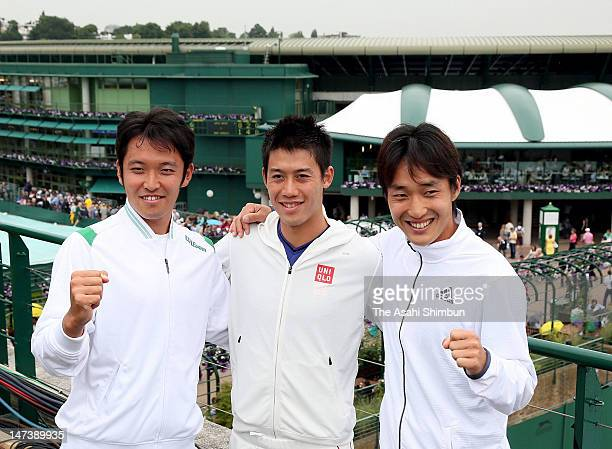 Tatsuma Ito Kei Nishikori and Go Soeda pose for photographs after their qualification to London Olympic during the Wimbledon tournament on June 27...