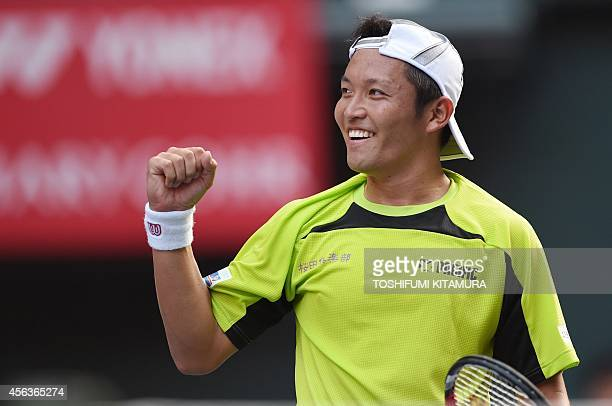 Tatsuma Ito of Japan clinches his fist after his victory over top seeded Stan Wawrinka of Switzerland during their men's singles first round match of...