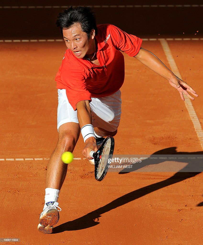 Tatsuma Ito of Japan hits a backhand vol