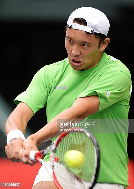 Tatsuma Ito of Japan in action during his men's first round match against Feliciano Lopez of Spain during day two of the Rakuten Open at Ariake...