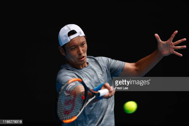 Tatsuma Ito of Japan in action during his Men's Singles second round match against Novak Djokovic of Serbia on day three of the 2020 Australian Open...