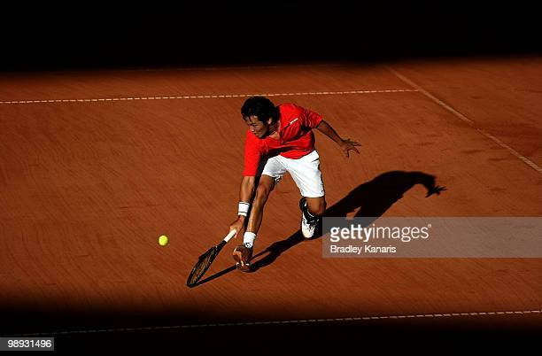 Tatsuma Ito of Japan plays a backhand during his match against Carsten Ball of Australia during the match between Australia and Japan on day three of...