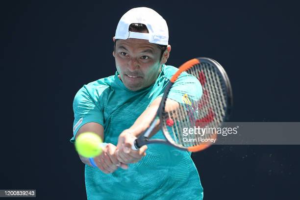 Tatsuma Ito of Japan plays a backhand during his Men's Singles first round match against Prajnesh Gunneswaran of India on day two of the 2020...