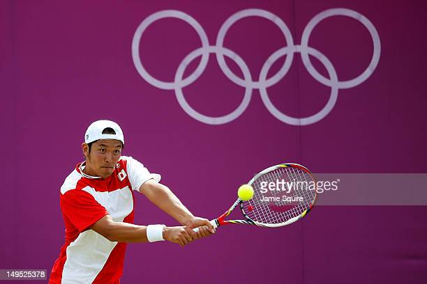 Tatsuma Ito of Japan plays a backhand during the Men's Singles Tennis match against Milos Raonic of Canada on Day 3 of the London 2012 Olympic Games...