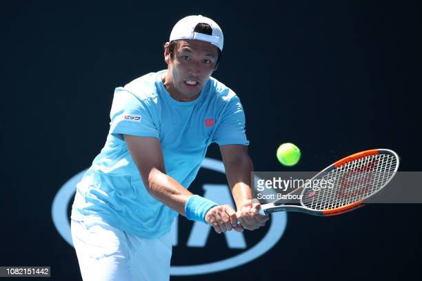 Tatsuma Ito of Japan plays a backhand in his first round match against Daniel Evans of Great Britain during day one of the 2019 Australian Open at...