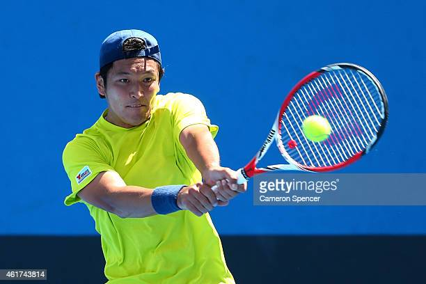 Tatsuma Ito of Japan plays a backhand in his first round match against Martin Klizan of Slovakia during day one of the 2015 Australian Open at...
