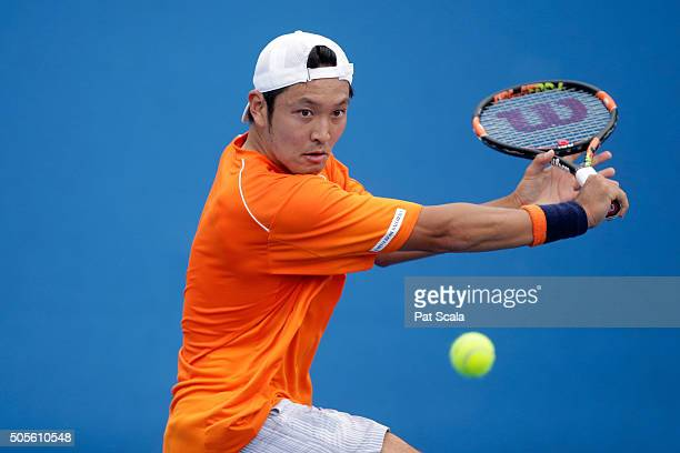 Tatsuma Ito of Japan plays a backhand in his first round match against Radek Stepanek of Czech Republic during day two of the 2016 Australian Open at...
