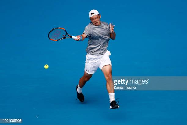 Tatsuma Ito of Japan plays a forehand during his Men's Singles second round match against Novak Djokovic of Serbia on day three of the 2020...