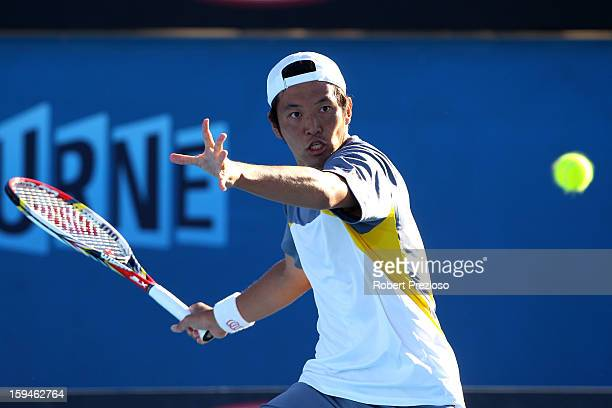 Tatsuma Ito of Japan plays a forehand in his first round match against John Millman of Australia during day one of the 2013 Australian Open at...