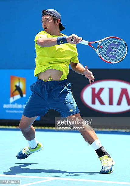 Tatsuma Ito of Japan plays a forehand in his first round match against Martin Klizan of Slovakia during day one of the 2015 Australian Open at...