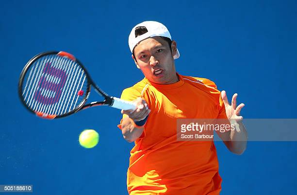 Tatsuma Ito of Japan plays a forehand in his match against Adrian MenendezMaceiras of Spain during the third round of 2016 Australian Open Qualifying...