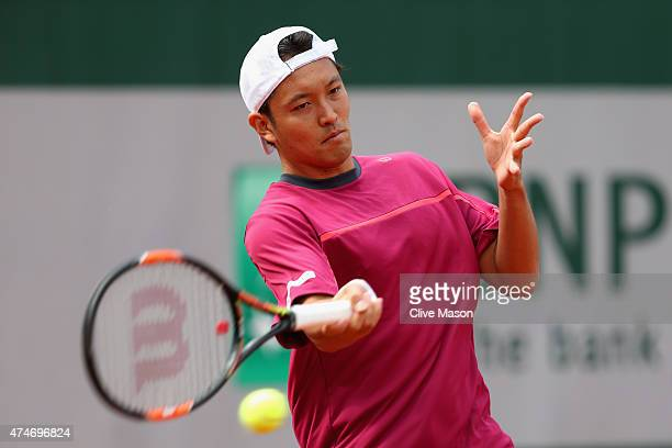 Tatsuma Ito of Japan plays a forehand in his Men's Singles match against Fabio Fognini of Italy on day two of the 2015 French Open at Roland Garros...