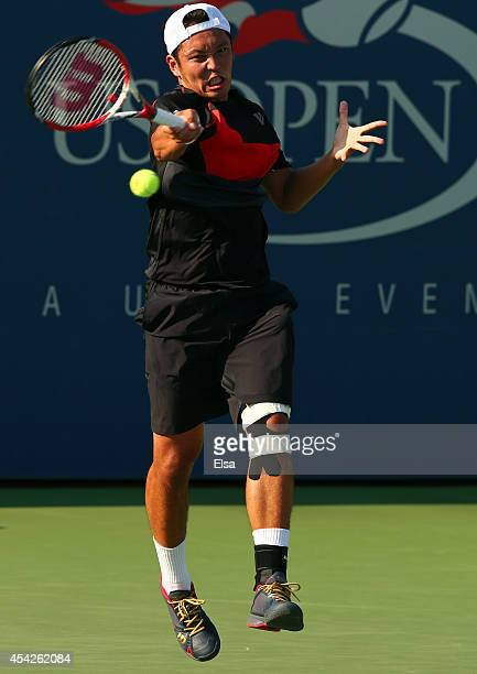 Tatsuma Ito of Japan returns a shot against Steve Johnson of the United States on Day Three of the 2014 US Open at the USTA Billie Jean King National...