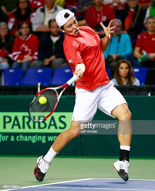 Tatsuma Ito of Japan returns a shot during his Davis Cup match against Milos Raonic of Canada March 6 2015 in Vancouver British Columbia Canada...