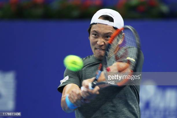 Tatsuma Ito of Japan returns a shot in the first round match against Wu Di of China on Day one of 2019 ATP World Tour 250 Zhuhai Championships at...