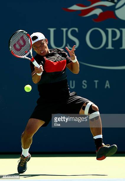 Tatsuma Ito of Japan returns a shot to Feliciano Lopez of Spain during their men's singles second round match on Day Five of the 2014 US Open at the...