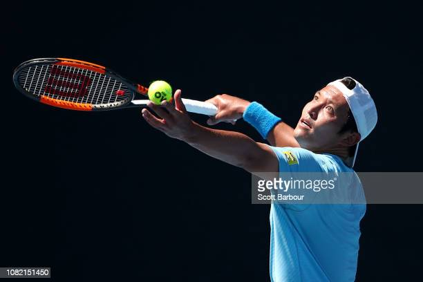Tatsuma Ito of Japan serves in his first round match against Daniel Evans of Great Britain during day one of the 2019 Australian Open at Melbourne...