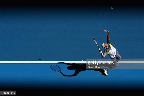 Tatsuma Ito of Japan serves in his second round match against Marcos Baghdatis of Cyprus during day three of the 2013 Australian Open at Melbourne...