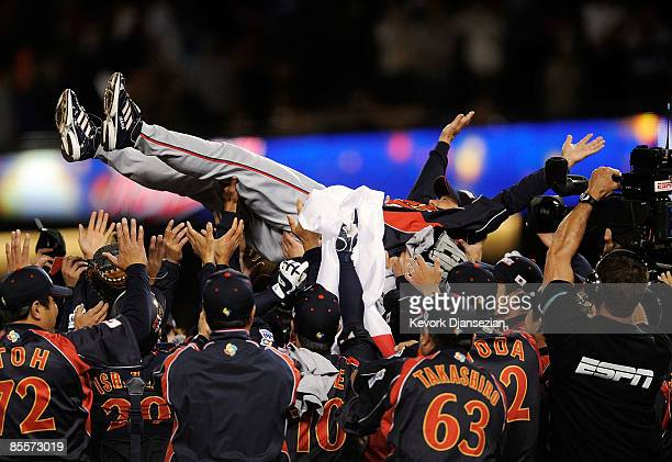 Tatsunori Hara manager of Japan is tossed in the air after Japan defeated Korea during the finals of the 2009 World Baseball Classic on March 23 2009...
