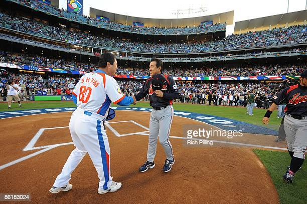 Tatsunori Hara manager of Japan shakes hands with In Sik Kim manager of Korea prior to the game between Korea and Japan during the World Baseball...