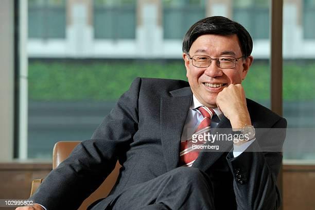 Tatsuo Tanaka, deputy president of Bank of Tokyo Mitubishi UFJ Ltd. And chief executive officer of global banking at the bank, poses for a photograph...