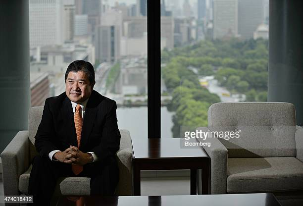 Tatsuo Yasunaga president and chief executive officer of Mitsui Co poses for a photograph in Tokyo Japan on Tuesday May 19 2015 Food health care and...