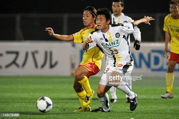 Tatsushi Koyanagi of Thespa Kusatsu and Tomoki Ikemoto of Giravanz Kitakyushu compete for the ball during the JLeague Second Division match between...