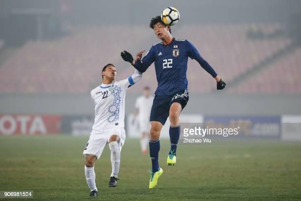 Tatsuta Yugo of Japan and Abdixolikov Bobir of Uzbekistan in action during AFC U23 Championship Quarterfinal between Japan and Uzbekistan at Jiangyin...