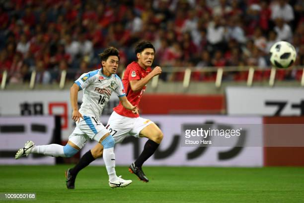 Tatsuya Hasegawa of Kawasaki Frontale and Daiki Hashioka of Urawa Red Diamonds compete for the ball during the J.League J1 match between Urawa Red...