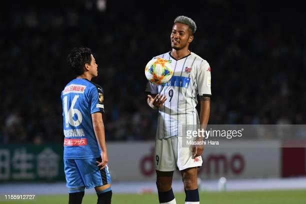 Tatsuya Hasegawa of Kawasaki Frontale and Musashi Suzuki of Consadole Sapporo look on before the Penalty kick during the J.League J1 match between...
