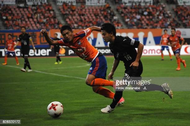 Tatsuya Hasegawa of Kawasaki Frontale and Naoki Kawaguchi of Albirex Niigata compete for the ball during the J.League J1 match between Albirex...