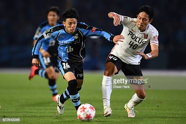 Tatsuya Hasegawa of Kawasaki Frontale and Ryota Moriwaki#46 of Urawa Red Diamonds compete for the ball during the 96th Emperor's Cup fourth round...