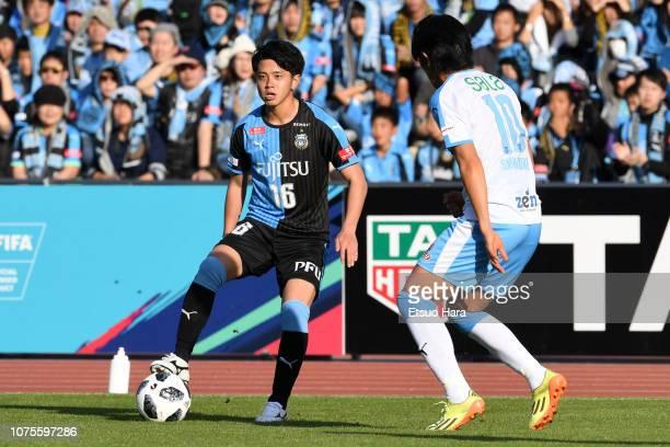 Tatsuya Hasegawa of Kawasaki Frontale and Shunsuke Nakamura of Jubilo Iwata compete for the ball during the J.League J1 match between Kawasaki...