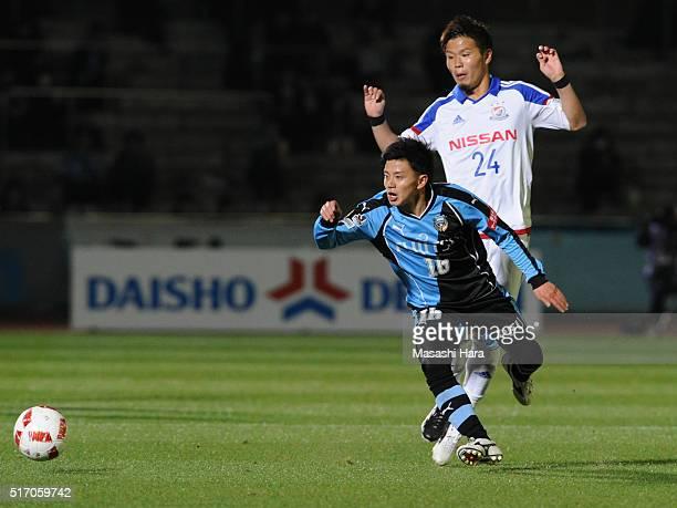 Tatsuya Hasegawa of Kawasaki Frontale and Takashi Kanai of Yokohama F.marinos compete for the ball during the J.League Yamazaki Nabisco Cup match...