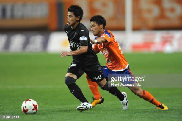 Tatsuya Hasegawa of Kawasaki Frontale and Yuto Horigome of Albirex Niigata compete for the ball during the J.League J1 match between Albirex Niigata...