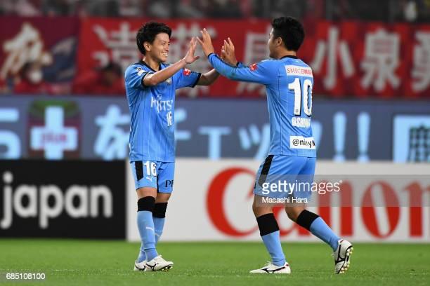 Tatsuya Hasegawa of Kawasaki Frontale celebrates scoring his side's second goal with his team mate Ryota Oshima during the J.League J1 match between...