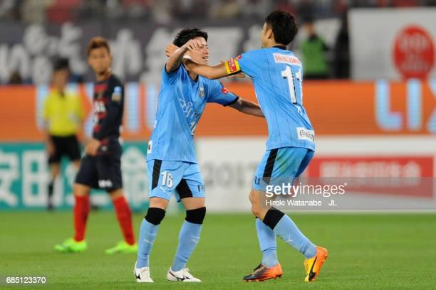 Tatsuya Hasegawa of Kawasaki Frontale celebrates scoring his side's second goal with his team mate Yu Kobayashi during the J.League J1 match between...