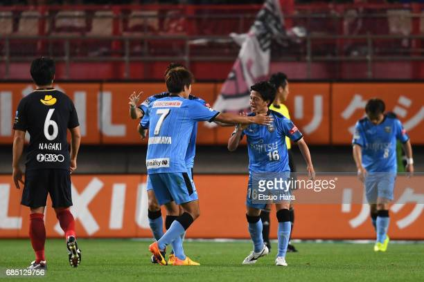 Tatsuya Hasegawa of Kawasaki Frontale celebrates scoring his side's second goal with his team mates during the J.League J1 match between Kashima...