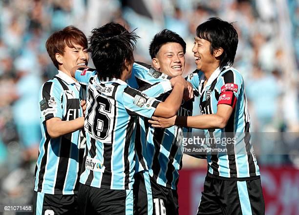 Tatsuya Hasegawa of Kawasaki Frontale celebrates scoring his team's first goal with his team mates during the J.League match between Kawasaki...