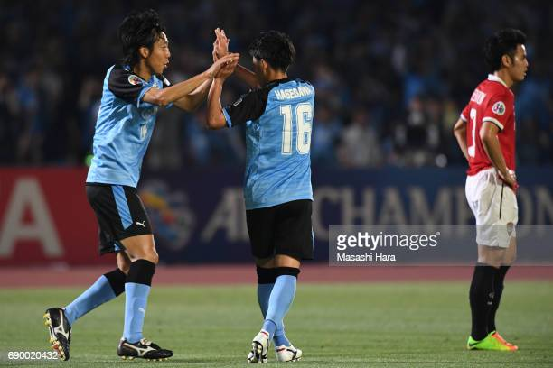 Tatsuya Hasegawa of Kawasaki Frontale celebrates the second goal with Kengo Nakamura during the AFC Champions League Round of 16 match between...