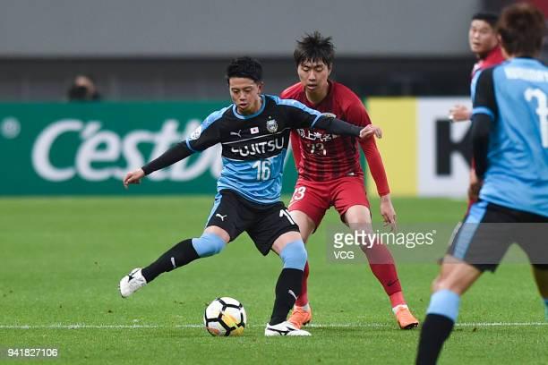 Tatsuya Hasegawa of Kawasaki Frontale controls the ball during AFC Champions League Group F match between Shanghai SIPG and Kawasaki Frontale at the...
