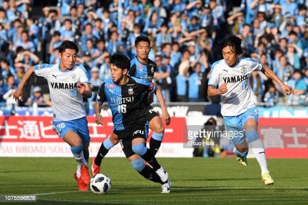 Tatsuya Hasegawa of Kawasaki Frontale controls the ball under pressure of Rikiya Uehara and Shunsuke Nakamura of Jubilo Iwata during the J.League J1...