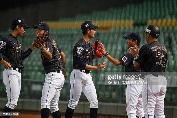 Tatsuya Imai of Japan walks onto dugout in the bottom half of the first inning in the game between Taiwan and Japan during the 11th BFA U18 Baseball...