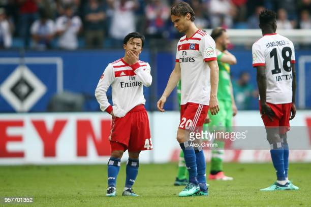 Tatsuya Ito Albin Ekdal and Bakery Jatta of Hamburg react after their team is relegated after during the Bundesliga match between Hamburger SV and...