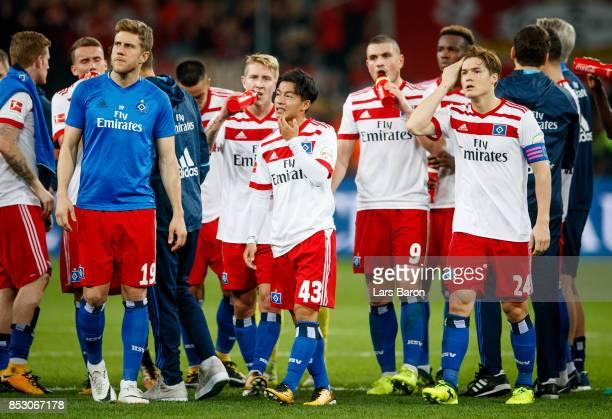 Tatsuya Ito and Gotoku Sakai of Hamburg are looking dejected after loosing the Bundesliga match between Bayer 04 Leverkusen and Hamburger SV at...