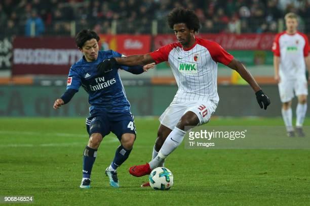 Tatsuya Ito of Hamburg and Francisco da Silva Caiuby of Augsburg battle for the ball during the Bundesliga match between FC Augsburg and Hamburger SV...