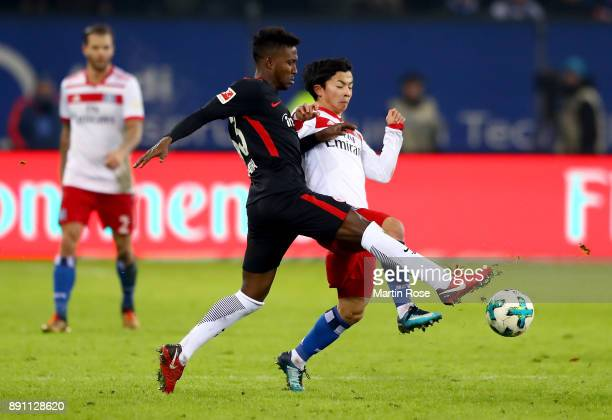 Tatsuya Ito of Hamburg and Talb Tawatha of Frankfurt battle for the during the Bundesliga match between Hamburger SV and Eintracht Frankfurt at...
