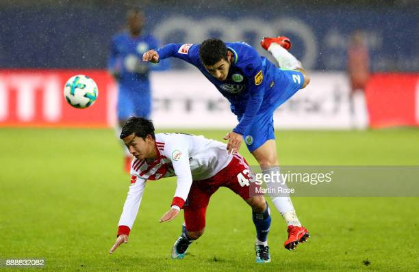 Tatsuya Ito of Hamburg and William of Wolfsburg battle for the ball during the Bundesliga match between Hamburger SV and VfL Wolfsburg at...